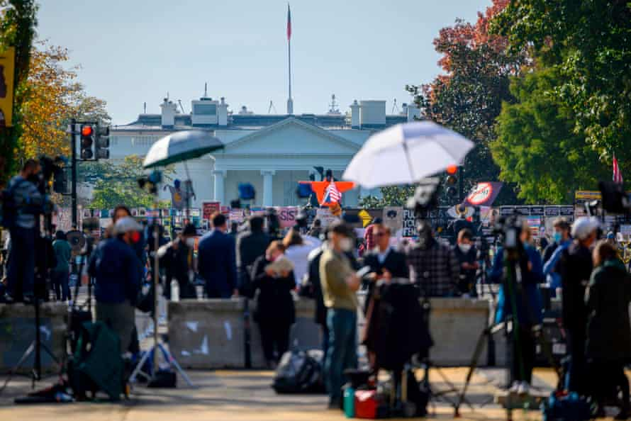 Journalists from all over the world wait for the result of the US presidential election on Black Lives Matter Plaza in front of the White House, 6 November 2020.