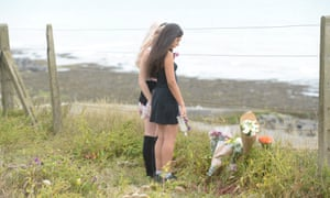 Friends laying flowers and tributes at the site where Arthur fell.