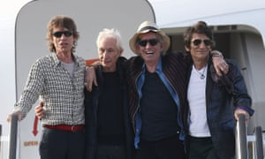 Mick Jagger, Charlie Watts, Keith Richards and Ronnie Wood of the Rolling Stones exit their plane after landing at José Martí airport in Havana on Thursday.