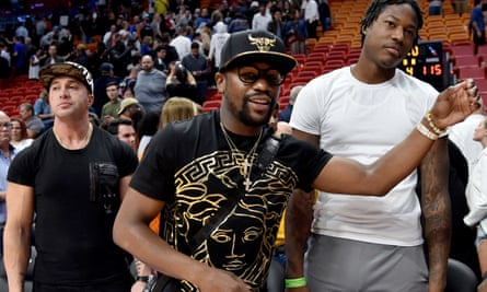 Floyd Mayweather Jr, center, received $100,000 to promote an offering from Centra Tech, a cryptocurrency company.