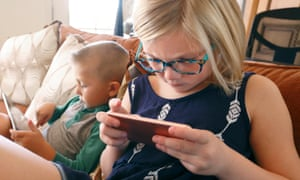 Children looking at handheld devices