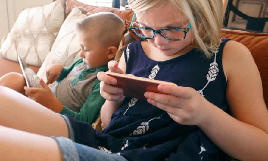 Children playing with digital devices.