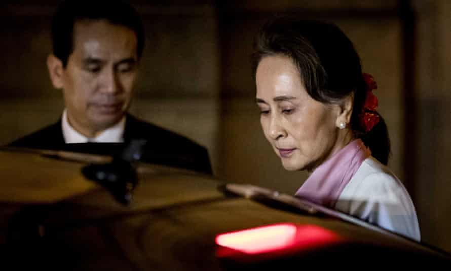 Aung San Suu Kyi leaves the Peace Palace after the third day of hearings on the Rohingya genocide case in the Hague, the Netherlands, on Thursday