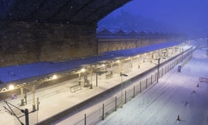 Edinburgh Waverley station was closed on Thursday as the platforms were blanketed in snow.