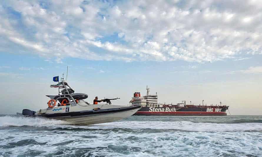 Iranian Revolutionary Guards in speedboats patrolling a tanker Stena Impero