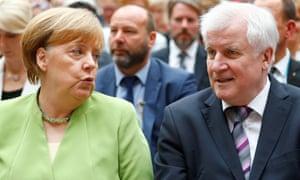 Angela Merkel with Horst Seehofer in Berlin last month.