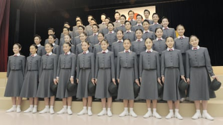 The 100th batch of students of Takarazuka Music School line up for photos during their entrance ceremony at the school in Takarazuka, Hyogo Prefecture, on 16 April 2012.