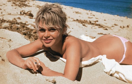 Brigitte Bardot on the beach in classic mid-20th- century pose