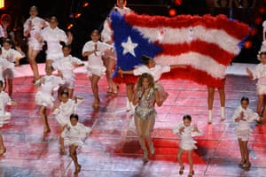 Singer Jennifer Lopez performs while a Puerto Rican flag is displayed on stage during the Pepsi Super Bowl LIV half-time show in Miami, Florida.