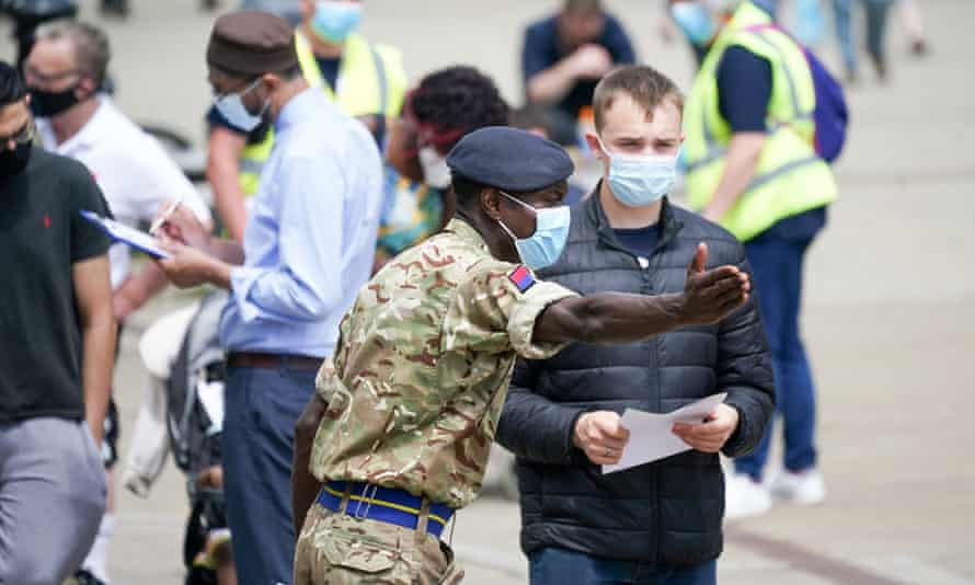 Soldiers from the Royal Horse Artillery at a rapid vaccination centre set up outside Bolton town hall to help curb the spread of the Delta variant in the region