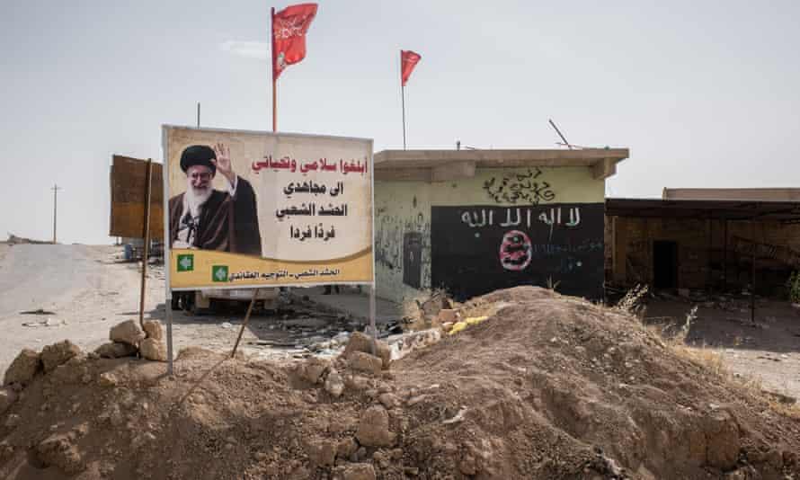 Shia signs replace Islamic State ones near Ba'aj.