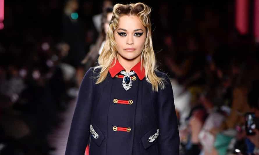 Rita Ora walks the runway at the Miu Miu show as part of Paris fashion week earlier this year.