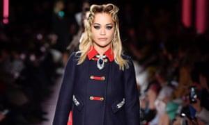 Rita Ora walks the runway at the Miu Miu fashion show earlier this year.