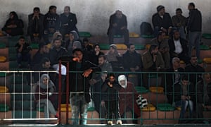 Palestinians wait in a stadium in hope of crossing into Egypt through the Rafah border crossing.