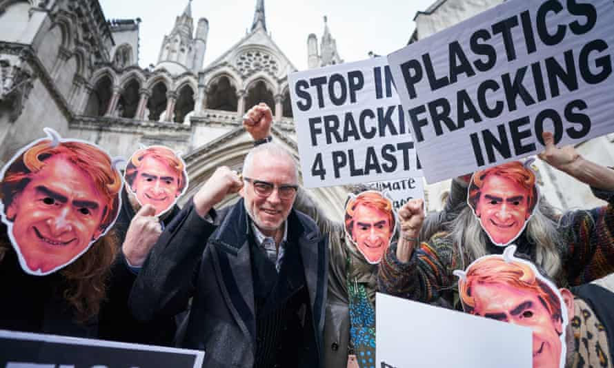 Protesters wearing masks of Ineos CEO Jim Ratcliffe at the high court in London.