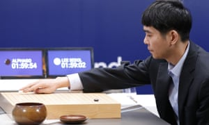 Lee Sedol plays his first stone during the fourth match on Sunday.