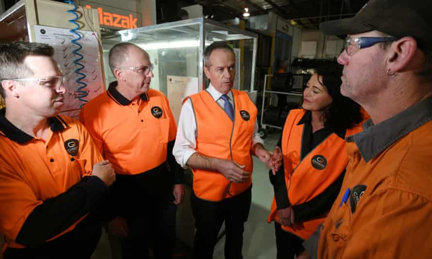 Bill Shorten speaks to workers during a visit to Carbon Revolution in Geelong during the election campaign