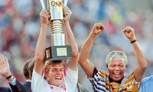 Nelson Mandela celebrates as South Africa's captain, Neil Tovey, lifts the African Cup of Nations trophy in 1996.