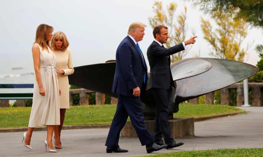 Emmanuel Macron and his wife, Brigitte, welcoming Donald Trump and his wife, Melania, to the G7 dinner