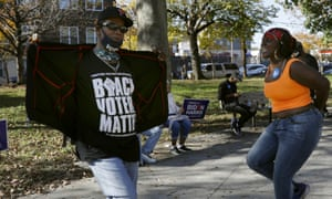 """A man wears a shirt that says, """"Black voters matter,"""" while dancing, Sunday, Nov. 8, 2020, in Fairhill Suare Park in Philadelphia, to celebrate after Democrat Joe Biden defeated President Donald Trump to become 46th president of the United States. (AP Photo/Rebecca Blackwell)"""