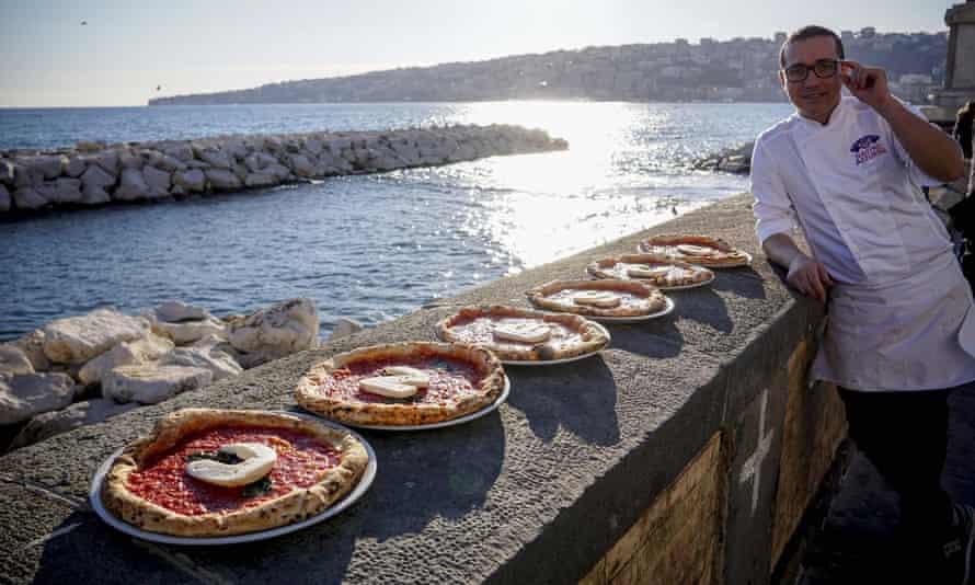 Italian chef Gino Sorbillo with pizza spelling out 'Unesco' in Naples