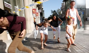 People leave a cordoned off area in Las Ramblas after the van ploughed into tourists.