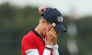 Nelly Korda with head in hands.