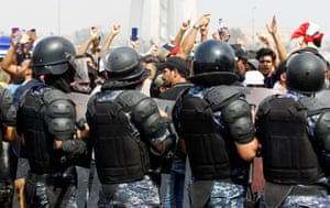 Baghdad, Iraq: security forces stand guard at a protest against unemployment, corruption and poor public services