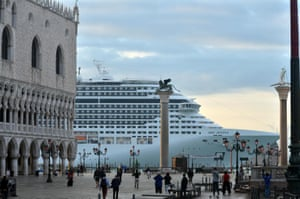 A cruise ship passes in front of San Marco Square in Venice.