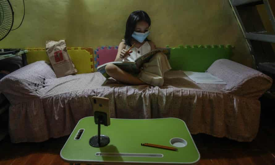Kylie Larrobis, an incoming first grade student, studies at her home in Quezon City, suburban Manila, ahead of another school year of remote lessons in the Philippines due to the pandemic.
