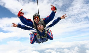 Skydiving photo. Tandem.Tandem jump in the sky with clouds.