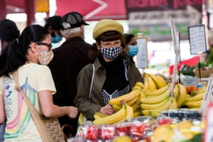 Locals shop for fresh food in the Queen Victoria Market in Melbourne at the weekend