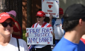 A woman at a rally in Florida holds a placard in support of Amy Coney Barrett.