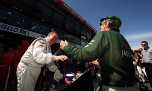 Alan Henry, left, with Jackie Stewart in 2000 as he prepares for a few laps of the Melbourne circuit in a two-seater McLaren.