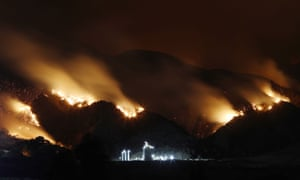 Trotter: 'The fire was spreading quickly across Los Angeles and went on to burn more than 23,000 acres of the Cleveland national forest. This image was taken in a residential park below the hills as the fire made its way down from the mountains towards an industrial area. Getty Images photographer Mario Tama placed the camera on a tripod to create the long exposure required to capture the blur of smoke and flames. Luckily, firefighters were able to contain the fire before it reached this industrial storage facility, but the image evokes the sense of impending danger that these fires bring.'