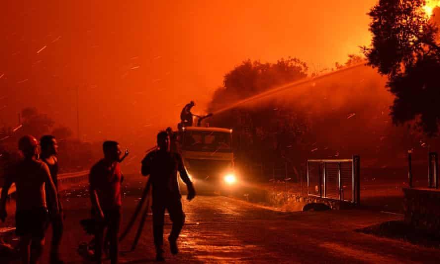 Firefighters battle a blaze in Mulga, Turkey, last week