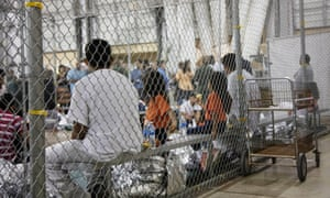 Migrants accused of illegal entry to the US in a caged facility in Texas