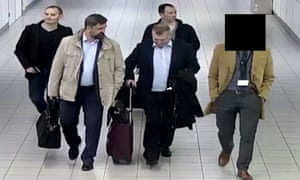 A handout photograph from the Dutch defence ministry shows four Russian intelligence officers at Schiphol airport, the Netherlands, on 10 April.