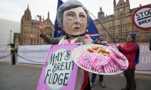 A protester dressed as Theresa May Maybot offering fudge outside Parliament.