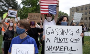 Demonstrators stage a protest near the Saint John Paul II National Shrine, where President Donald Trump planned a visit on Tuesday.