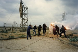 Paparazzi, Dungeness 1989: the Christ figure and Joseph are pursued across the Dungeness shingle by Balaclava-wearing paparazzi, with Jarman filming on an 8mm camera on the far left.