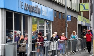 Customers queue outside The Co-Operative bank on 15 June 2020 in Stoke-on-Trent.