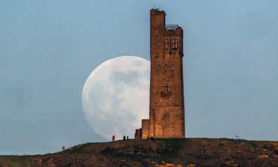 Almost full 'super moon' behind Victoria Tower on Castle Hill in Huddersfield, England.