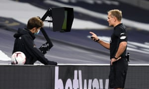 Referee Graham Scott consults VAR before awarding Brighton a goal.