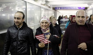 Syrian refugee Baraa Haj Khalaf holds the American flag