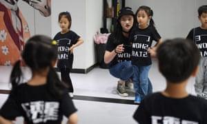 A teacher trains children at Le Show Stars modelling school