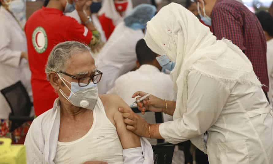 A man receives a dose of Covid-19 coronavirus vaccine in Dhaka