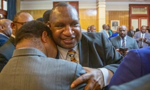 James Marape is hugged by a supporter after being sworn in as the new prime minister of Papua New Guinea.