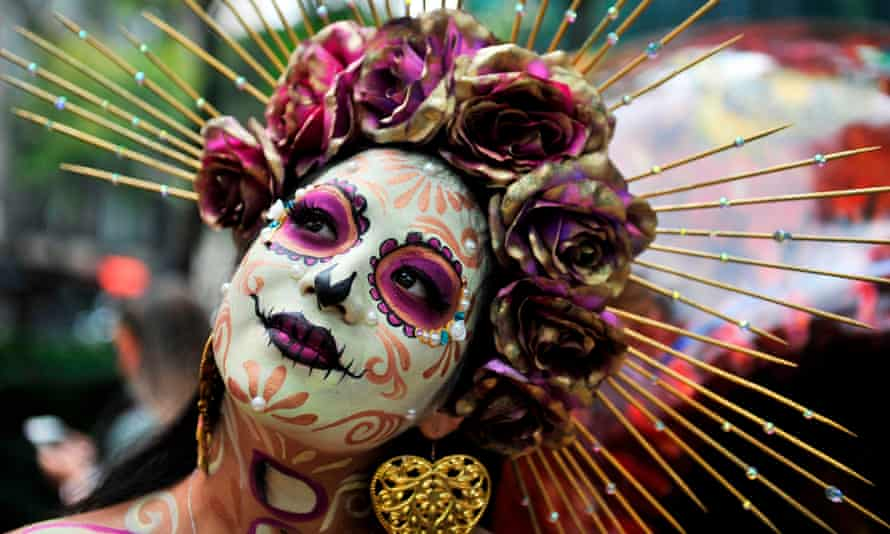"A woman takes part in the ""Catrinas Parade"" in Mexico City."