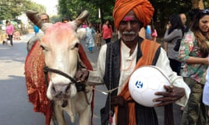 A man holds a Guardian Cities football on a pedestrianised road in Mumbai during the Cities 'live week' in the Indian megacity in 2014.